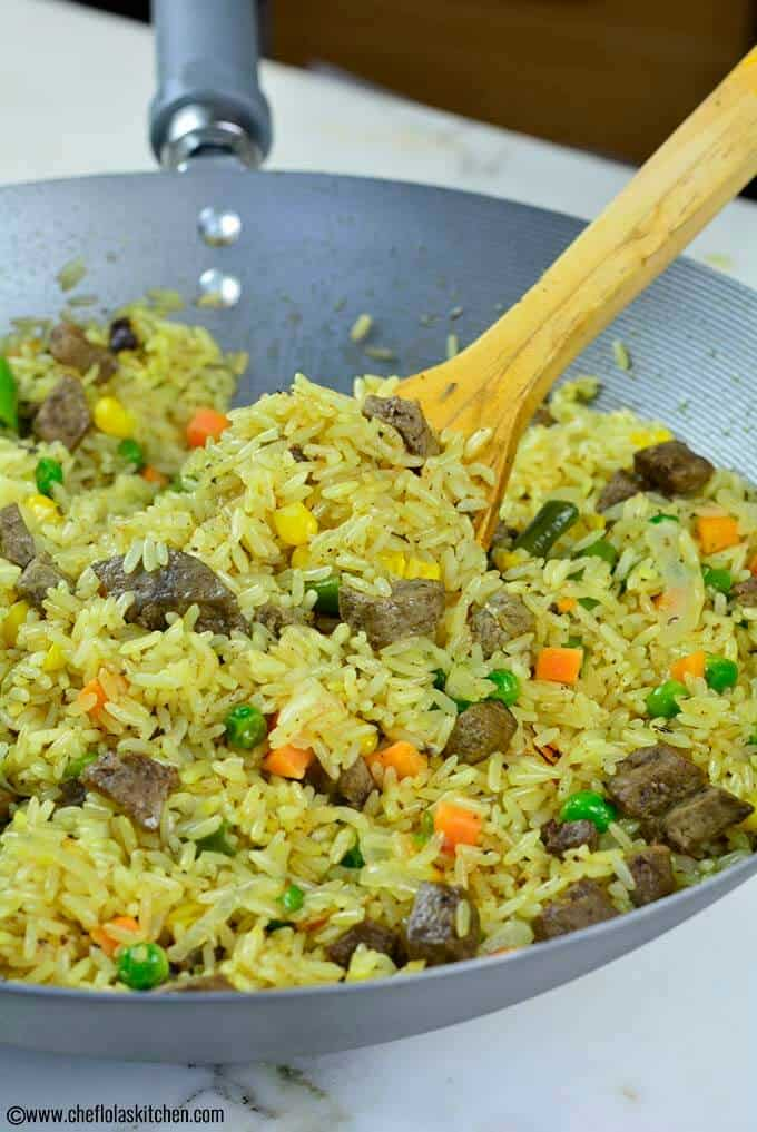 Close up picture of the delicious Nigerian Fried Rice loaded with mixed vegetables and beef Liver