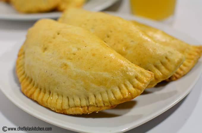 Nigerian Meat Pie served on a white plate just fresh from the oven