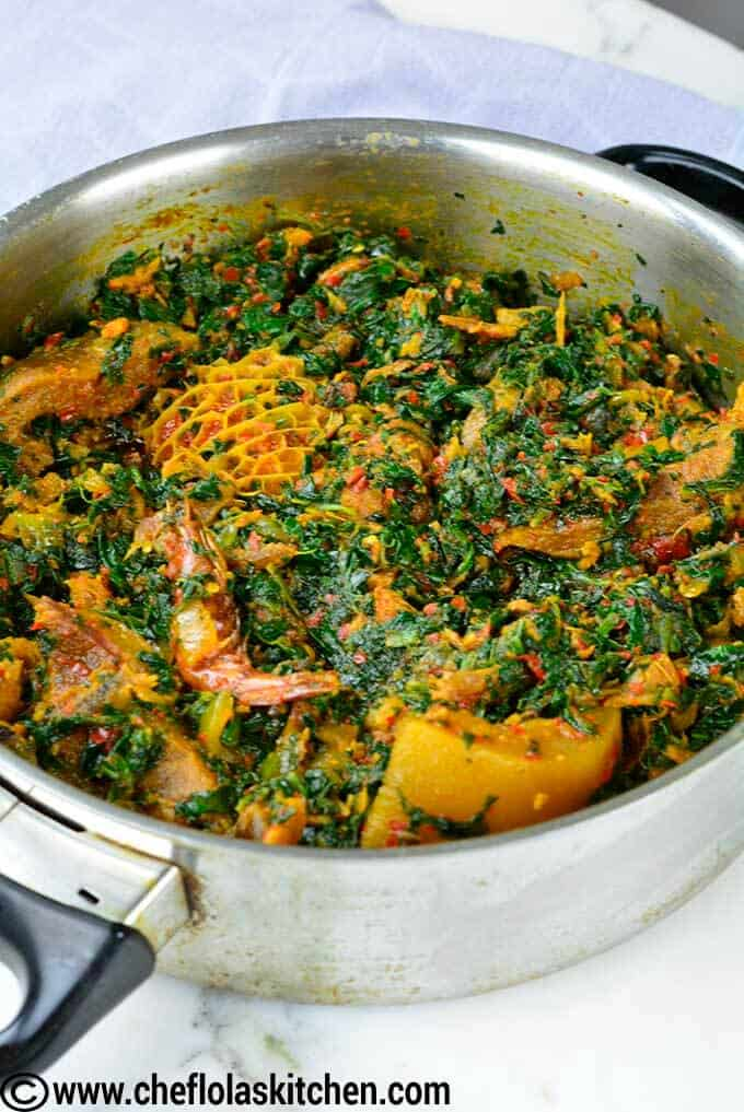 African stewed spinach - Spinach stirred in a rich sause filled with fish, meats, crayfish ... delicious!