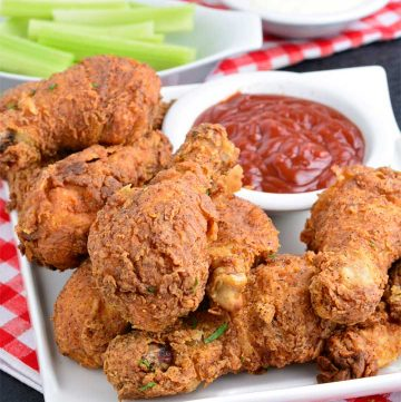 Crispy fried Chicken drumsticks with ketchup and celery sticks