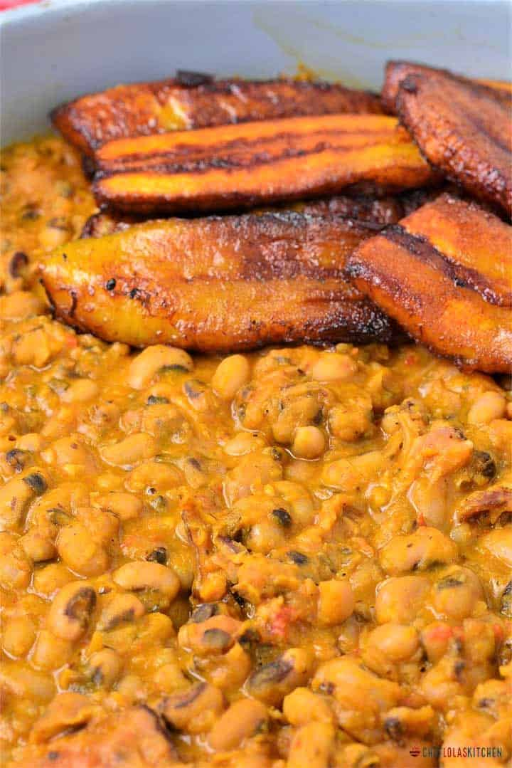 Ewa riro in a pot with plantains: Ewa riro is a Nigerian recipe and it is also referred to as stewed Beans or Beans Porridge