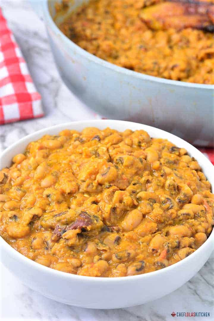 Ewa riro or Nigerian beans poridge served in a white bowl