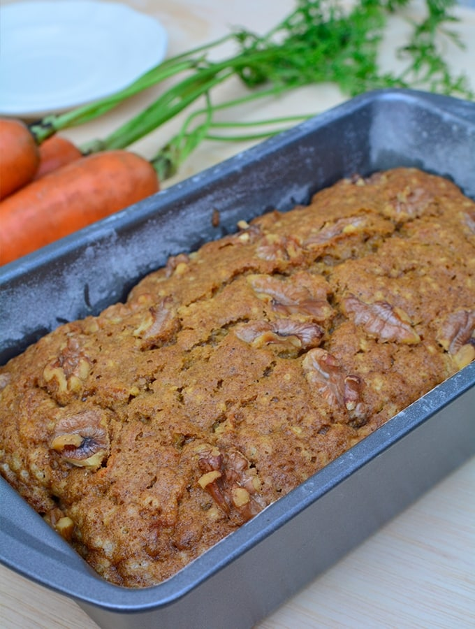 freshly baked carrot cake inside a loaf pan