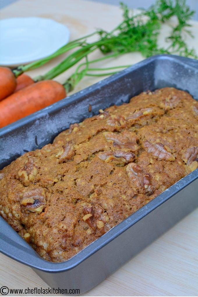 freshly baked carrot cake inside a loaf pan