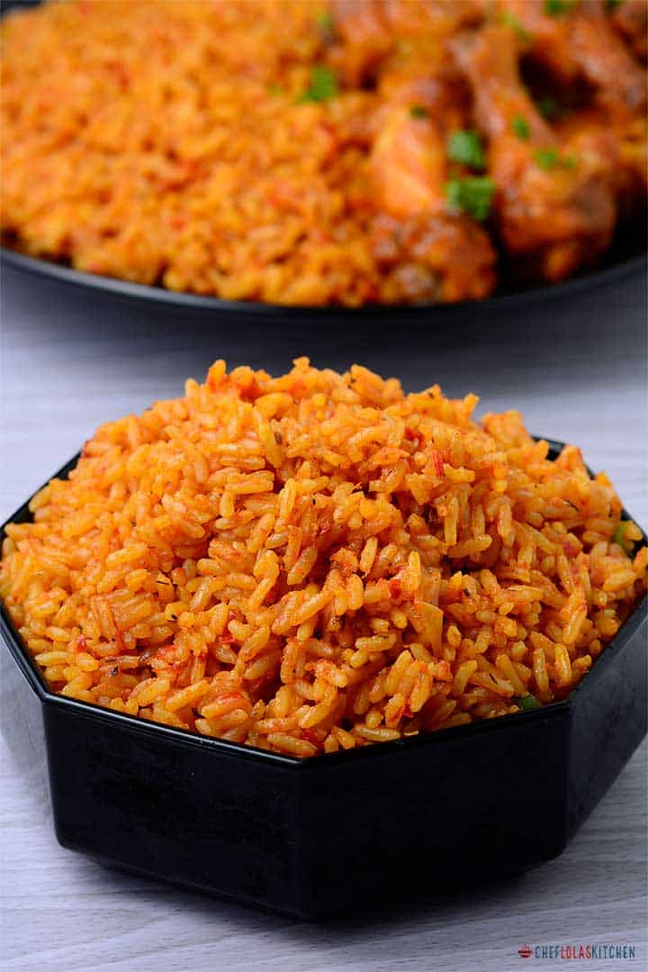 Jollof rice served in a black bowl