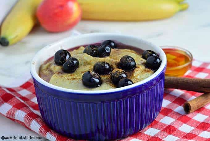 Cornmeal Porridge served in a cereal bowl. Garnished with blue berries
