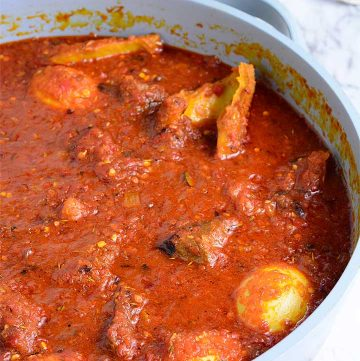 Nigerian pepper sauce with beef, tripe and boiled Eggs