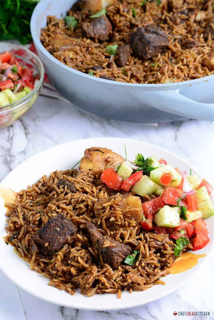 Rice pilau - fragrant tasty one-pot dish made with caramelized beef with rice and potato cooked in a rich and delicious meat or chicken broth.