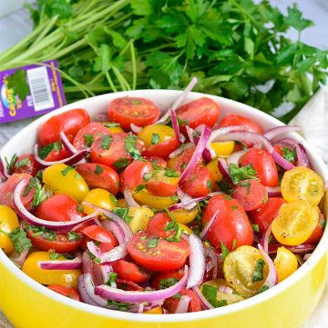Tomato Salad – made with ripe, juicy tomatoes, and crispy onions dressed with olive oil, vinegar, salt, and pepper.