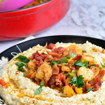 Shrimp is sauteed with peppers and sweet onion, and served over a bowl of hot cheese grits
