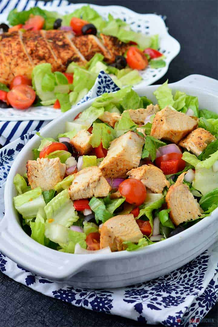 Diced baked Chicken served over salad