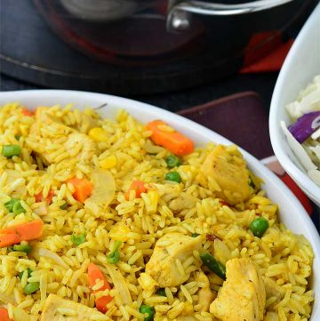 Nigerian fried Rice served in a white bowl