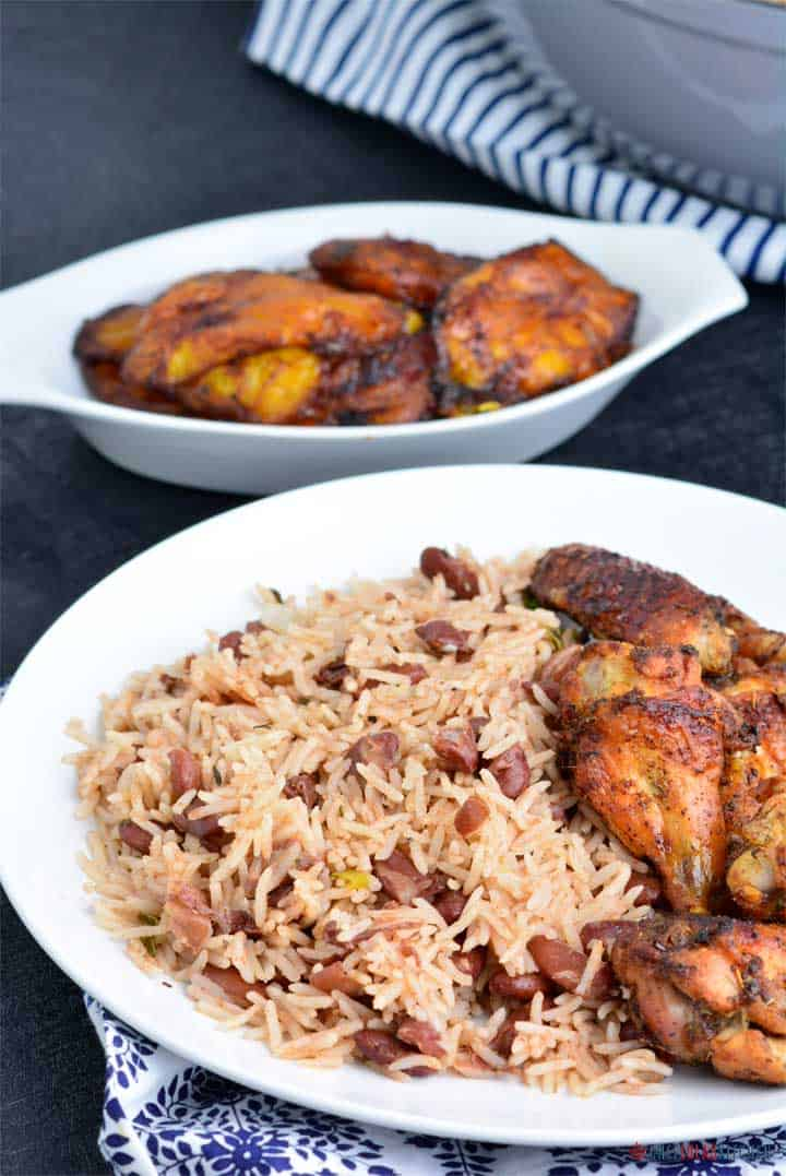 Rice and peas served with jerk chicken and plantain