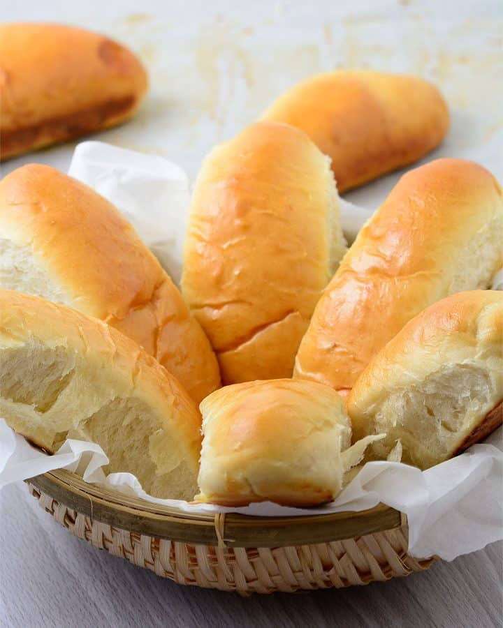 Hot dog buns in a small basket