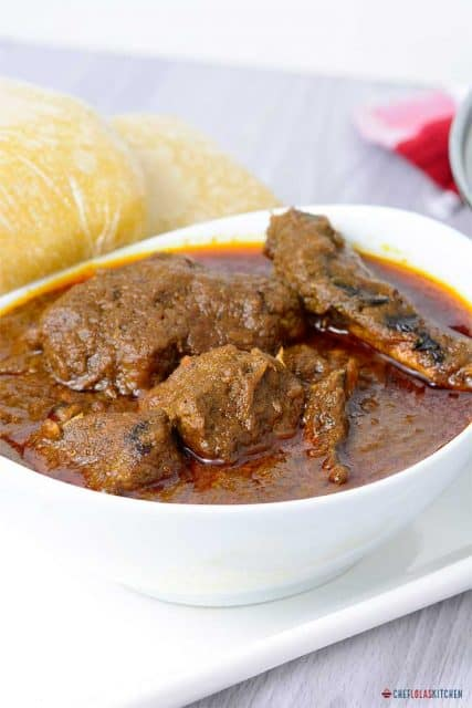 Banga Soup with meat served in a white bowl
