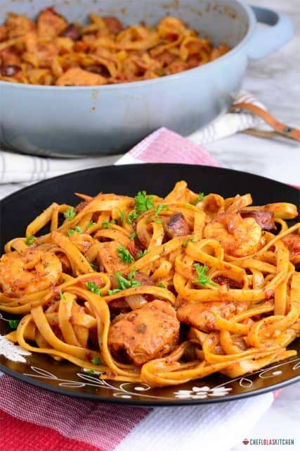 Jambalaya pasta served in a black plate
