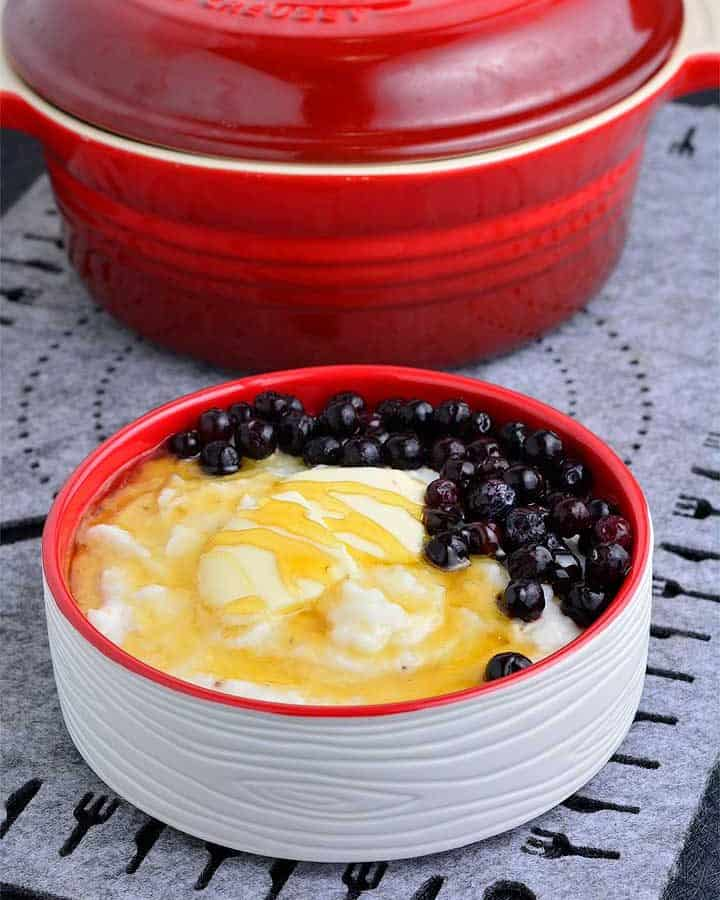 creamy grits served with honey and blue berries