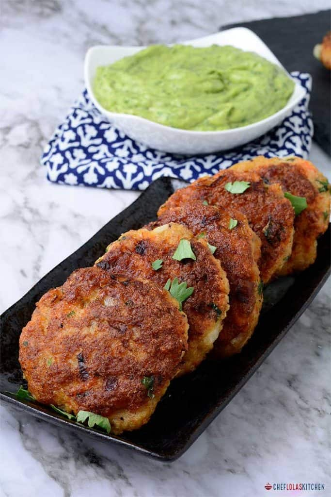 Shrimp cakes served in a plate. Garnished with parsley.