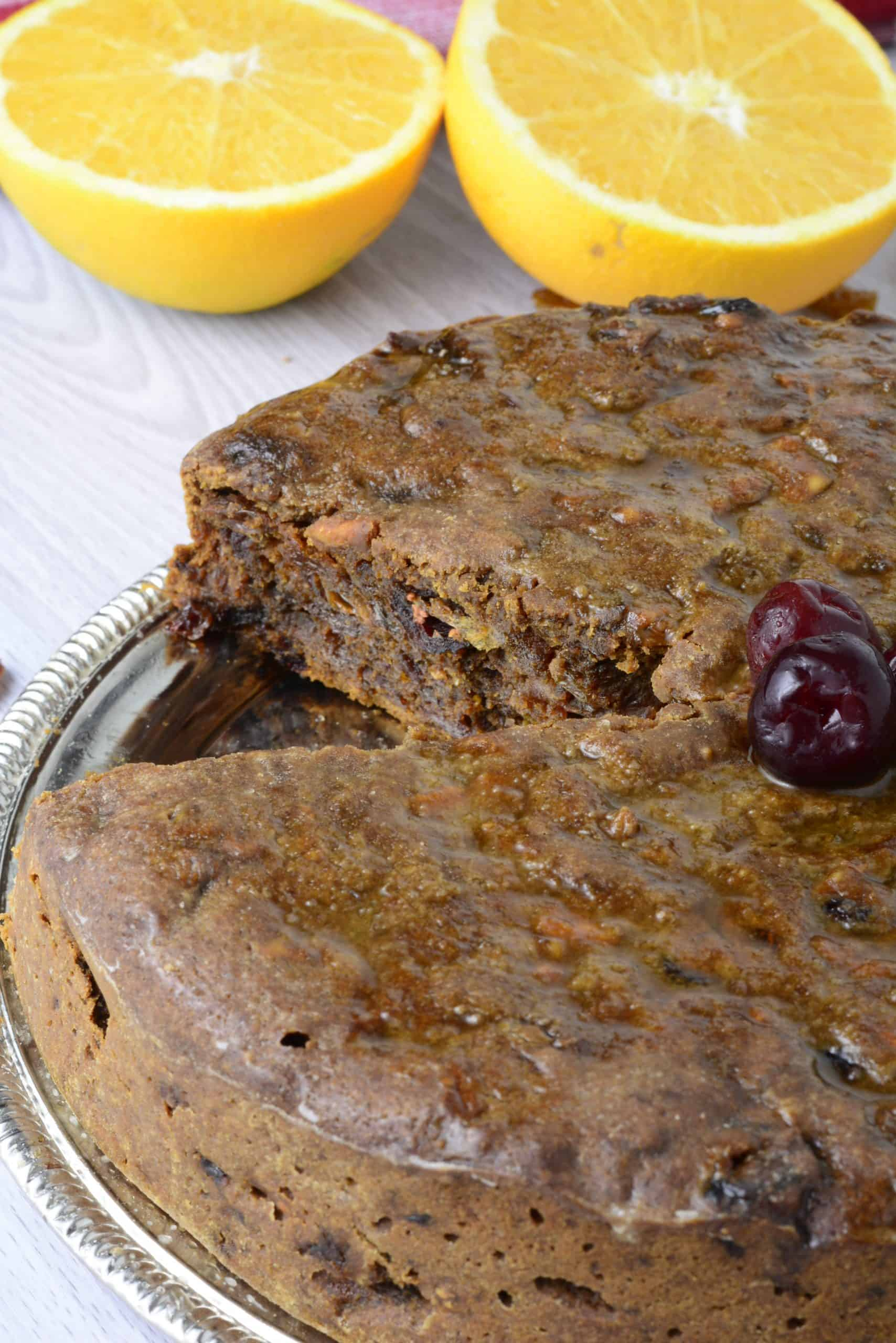 Freshly baked Christmas fruit cake decorated with bright red cherries