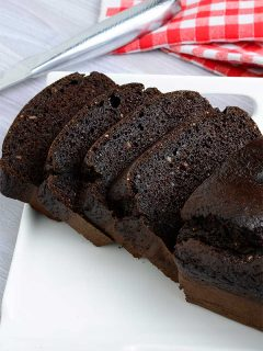 Sliced flourless chocolate cake on a plate
