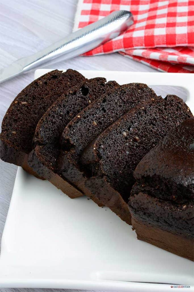Sliced flourless chocolate cake on a plate