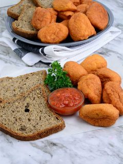 Akara served with bread slices and hot sauce
