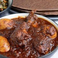 Doro wat served in a bowl