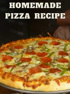 Hot homemade Pizza being taken out of the oven