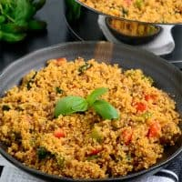 Couscous served in a bowl and garnished with basil.