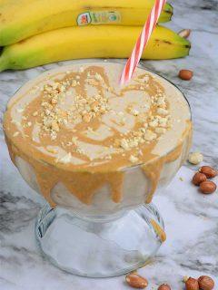 Banana peanut butter milk shake in a cup