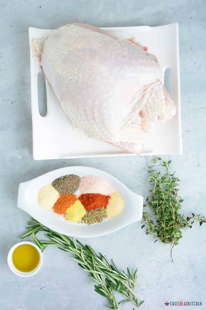 Fresh turkey breast with seasoning and herbs