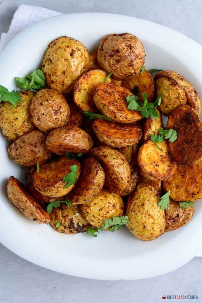 Air fryer crispy baby potatoes served in a white bowl