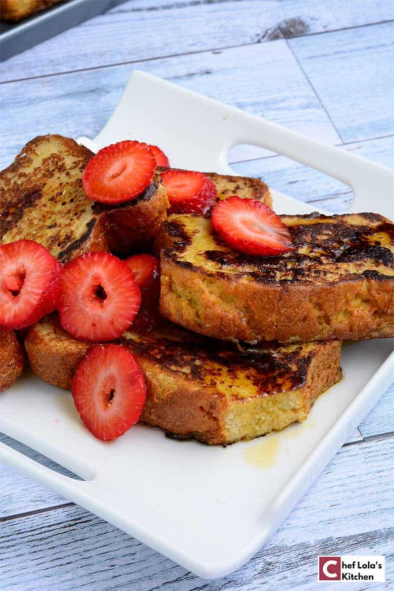 French Toast drizzled with honey and garnished with strawberries