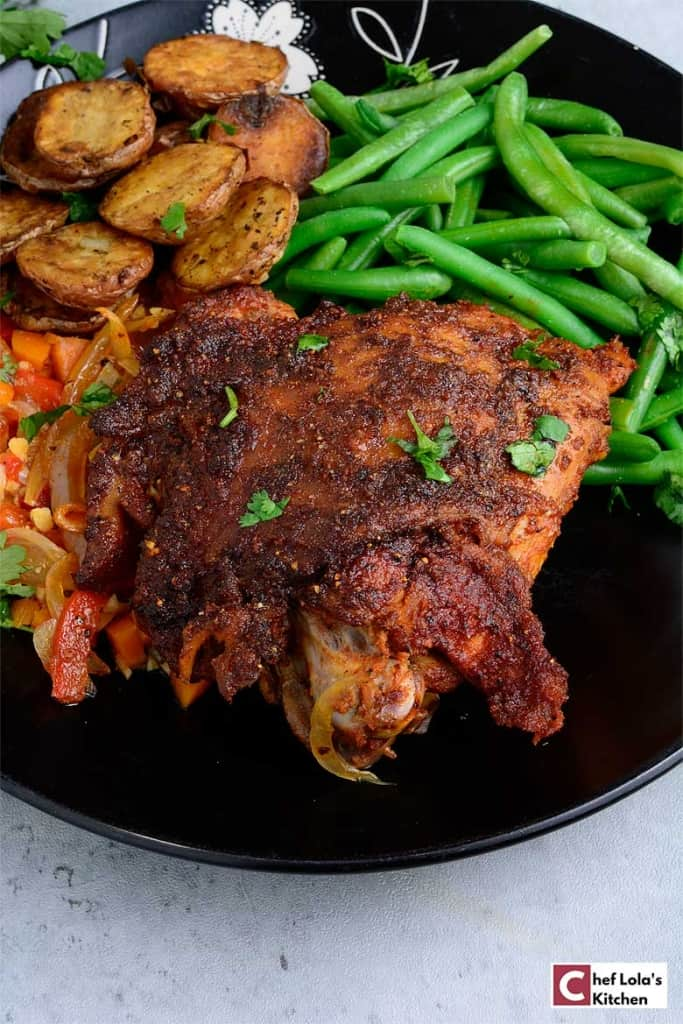 Oven Roasted Turkey Thighs served with roasted potatoes and green peas